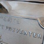 Polished Aluminium cistern, slight cartouche fault